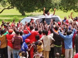 HH waves the UPND symbol to the Villagers in Milanzi Constituency in the Eastern Province who welcomed him