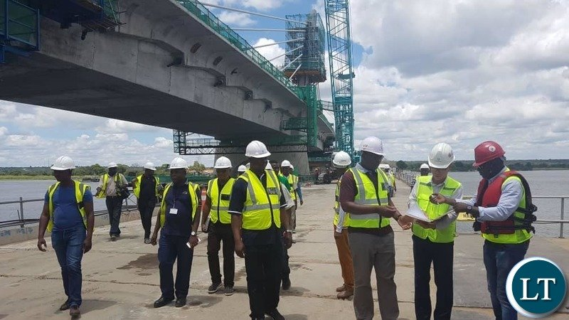 Minister of Works and Supply Hon. MUTOTWE KAFWAYA on a tour inspection of the Construction of the Kazungula Bridge