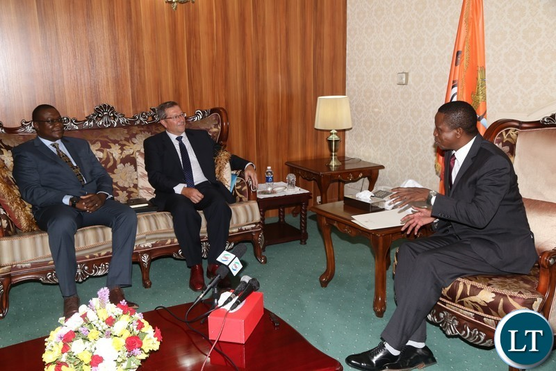 President Edgar Lungu talks to Lubambe Mine Chief Executive Officer Nick Bowen(c) when he paid a courtesy call on him at State House