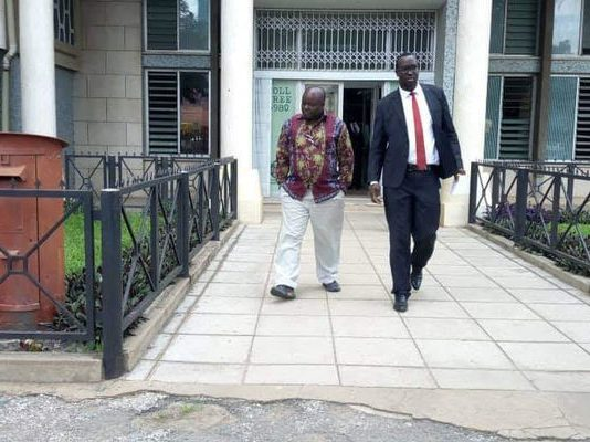 Minister of Infrastructure Ronald Chitotela on Tuesday leaving the ACC Headquarters in the company of his lawyer