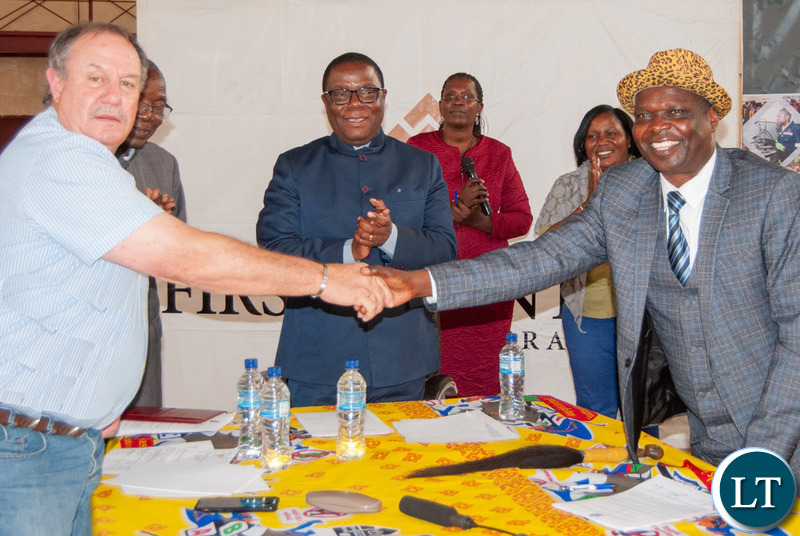 Senior Chief Musele and Kalumbila Minerals Ltd General Manager Morris Rowe shake hands after agreeing to closer co-operation between the mine and the local community