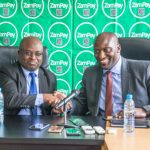ZICTA Director General Patrick Mutimushi shakes hands with Zamtel CEO Mr Sydney Mupeta after the launch of ZamSellit
