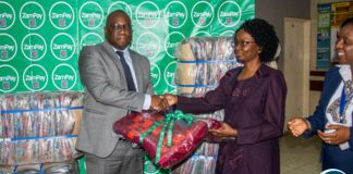 Zamtel Corporate Affairs Manager Chibeza Ngoma hands over blankets and linen to UTH Mother and Newborn Hospital Acting Senior Medical Superintendent Dr. Selia Nganjo during a Valentine Day donation at UTH