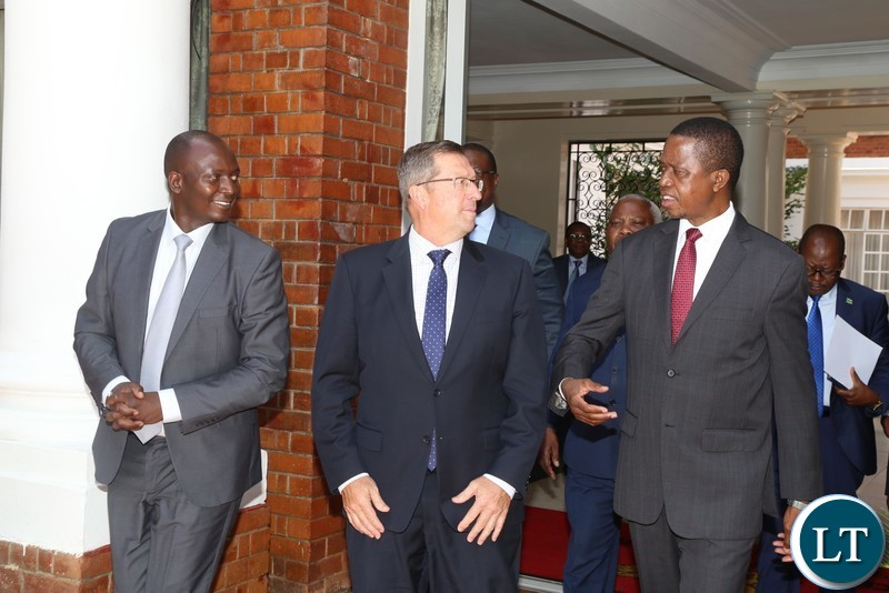 President Edgar Lungu talks to Lubambe Mine Chief Executive Officer Nick Bowen(c) while Mines Minister Richard Musukwa listens at State House