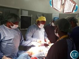 Ndola Teaching Hospital doctors operating on a patient