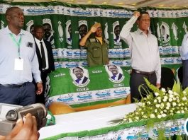 PF Secretary General Davis Mwila and President Lungu during the singing of the national Anthen During the opening of the Central Province Provincial Conference