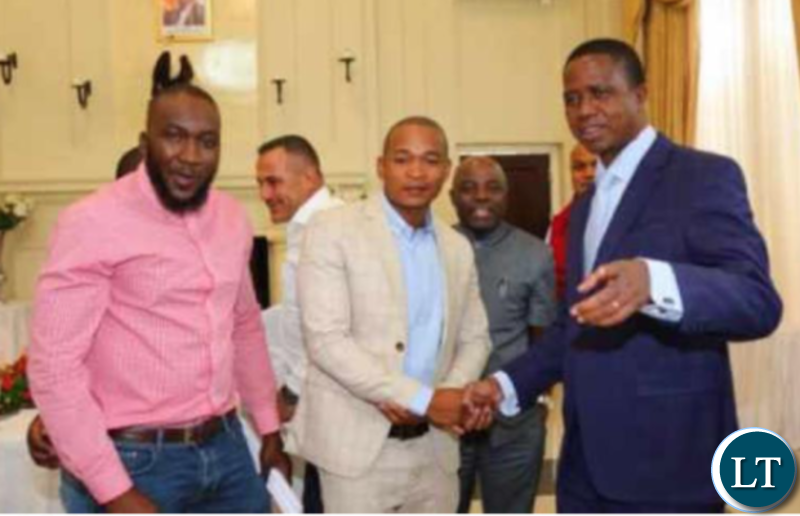 President Edgar Lungu shaking hands with Spax Mulenga, the current leader of the biggest jerabo group in Chingola, at State House recently. In the background is Shawi Fawaz.