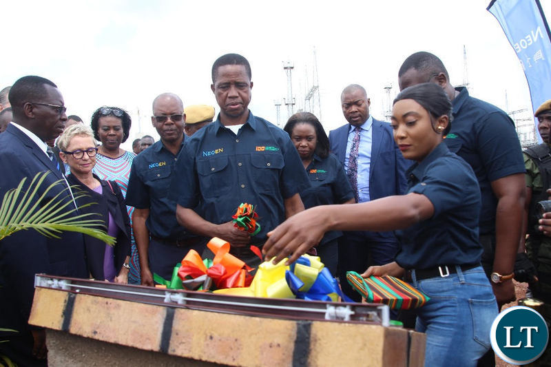 President Edgar Lungu cuts the ribbon to officially commission the solar project