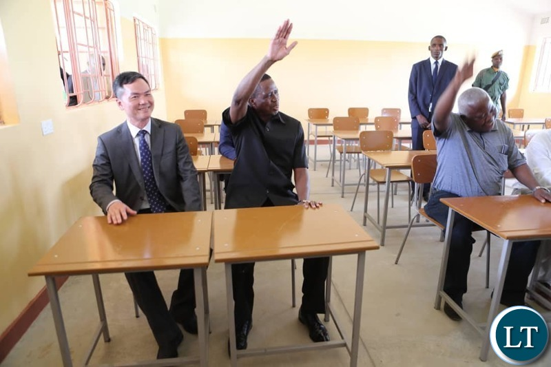 President Lungu , Chinese Ambassador to Zambia Lie Jie  and Presidential Affairs Minister Freedom Sikazwe in one of the classrooms for the School