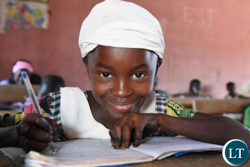 A girl attending class-PIX-UNICEF