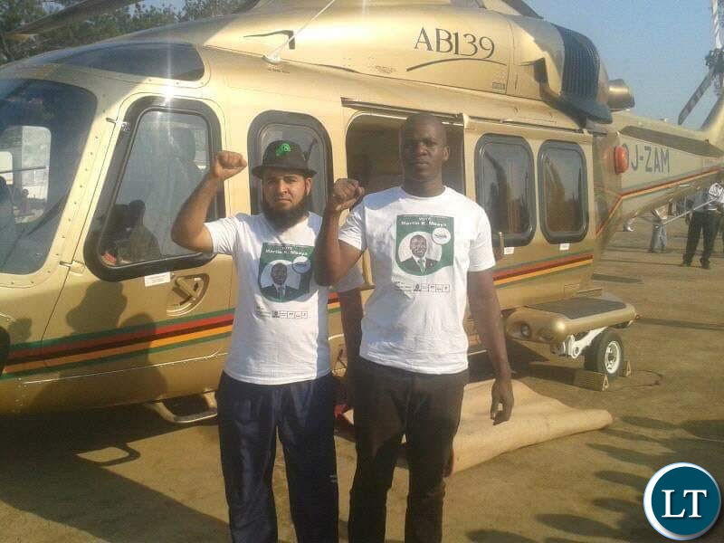 Huzaifa Jada with a fellow PF cadre pose for a photo near the presidential challenger plane.