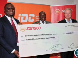 IDC Group CEO Mr Mateyo Kaluba (left), ZANACO Board Vice Chairperson Mr Hastings Mtine and ZANACO CEO Mr Henk Mulder (right) showing the dividend cheque.