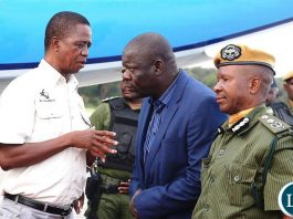 President Edgar Chagwa Lungu talks to PF Secretary General Davies Mwila at City Airport shortly before departure for Mansa, Luapula Province on Tuesday, April 23,2019-Pictures by THOMAS NSAMA