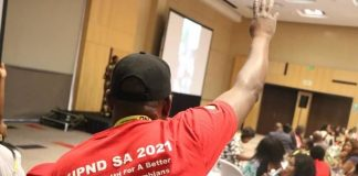 A UPND Cadre raises the PArty symbol to the delegates