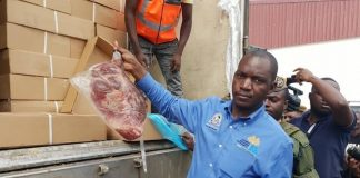 ZRA official displaying the confiscated meat
