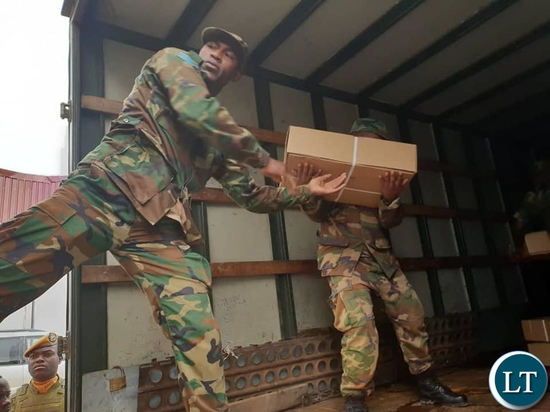 The confiscated  boxes of processed meat being offloaded from a truck