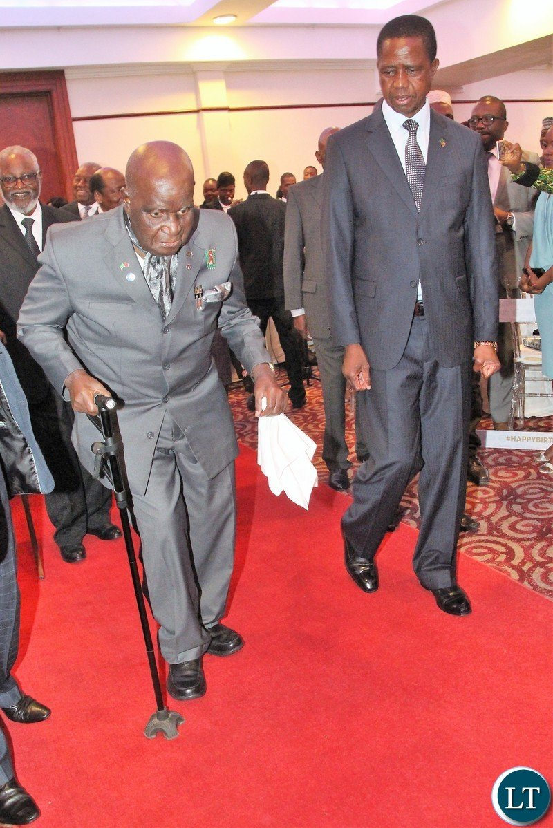 Zambia 1st president Kenneth Kaunda and president Edgar Lungu walking in hall during  state lunch in honour of Zambia 1st president Kenneth Kaunda.