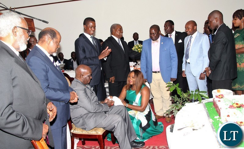 "KK being greeted by some of his grandchildren led by Musata Njvovu  who offered him a ""Musili"" tree as a gift.."