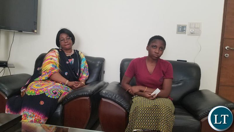 Zambia's High Commissioner to India Judith Kapijimpanga with stranded student Greatrest Mengo