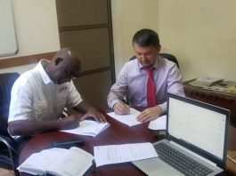AB Bank Chief Credit Officer Nurullo Mashrabov signs the MoU with Medeem Business Development Manager Musenge Nsakilwa.