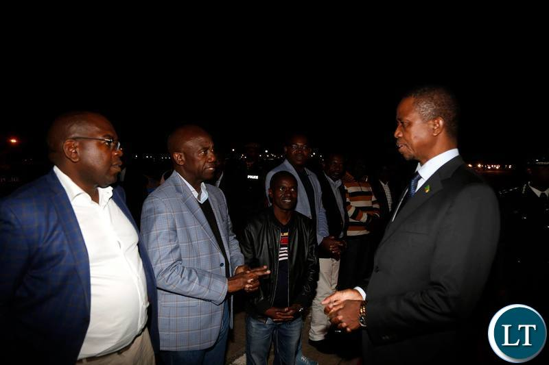 President Edgar Chagwa Lungu (right) talks to Acting Secretary to Cabinet Patrick Kangwa (second left) on arrival from Kinshasa,Democratic Republic of Congo at Zambia Air Force (ZAF) Base in Lusaka on Saturday,June 1 ,2019. PICTURE BY SALIM HENRY/STATE HOUSE ©2019