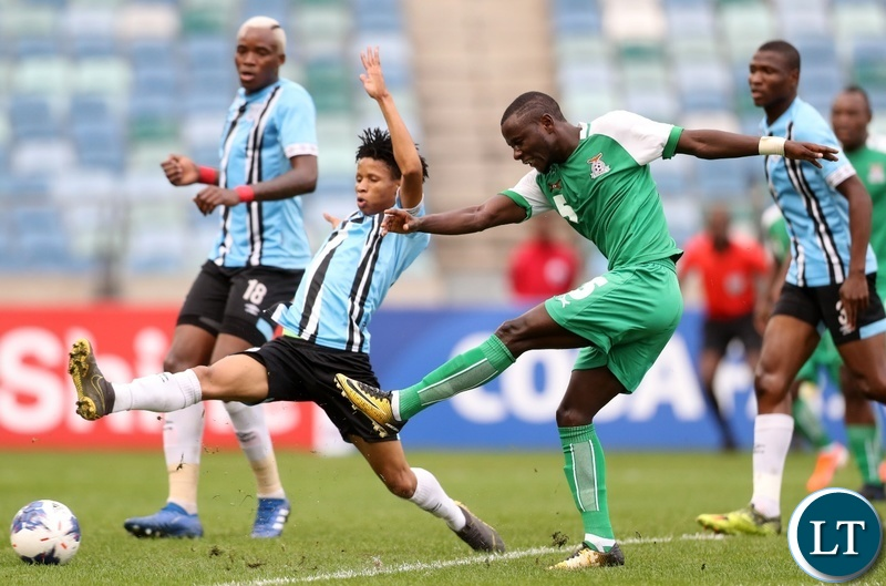 Austin Muwowo of Zambia challenged by Norman Mabaya of Botswana during the 2019 Cosafa Cup final match between Botswana and Zambia at Moses Mabhida Stadium, Durban on 08 June 2019 ©Samuel Shivambu/BackpagePix