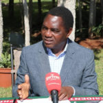 Mr Hichilema speaking at a news conference at his residence.