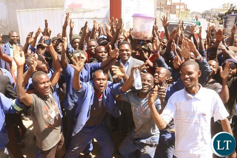 HH interacts with youths working in the Lusaka industrial area