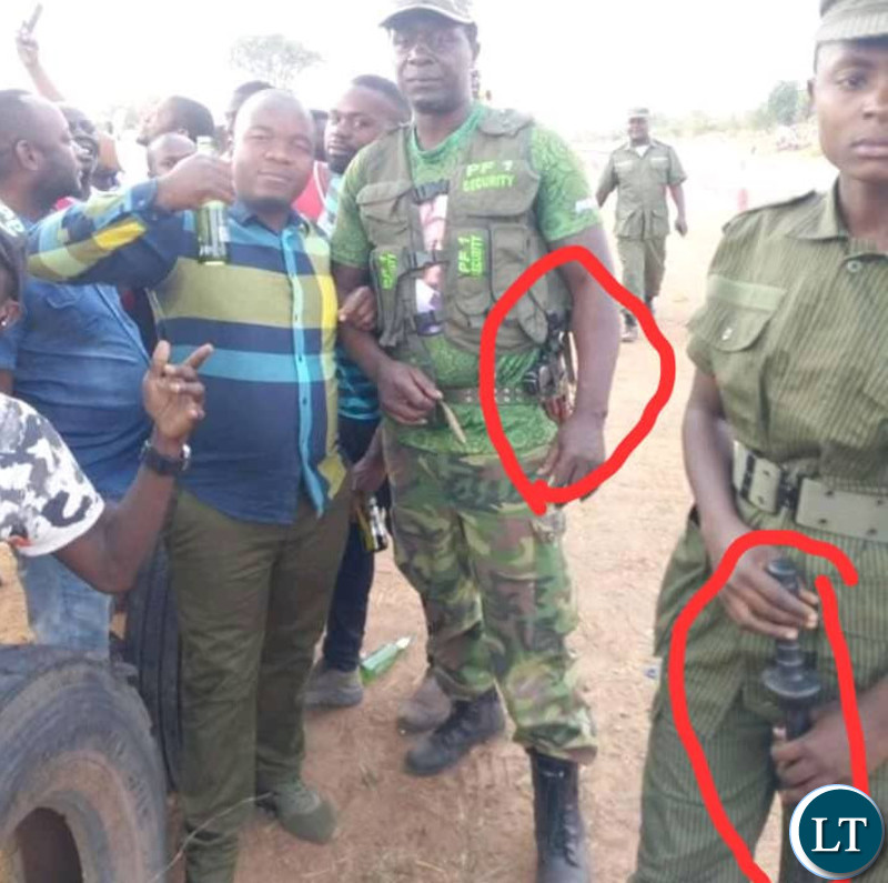 PF Cadres with Guns in a public place Guns