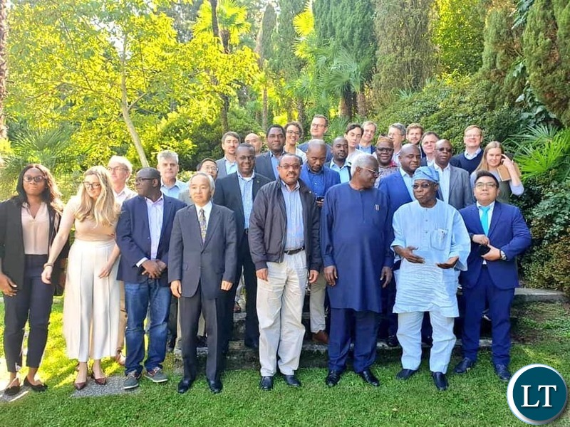 """President Hakainde Hichilema in a group photo with other eminent and distinguished personalities attending a meeting organised by the Brenhurst Foundation at Lake Como, Italy to discuss Africa's economic trajectory under a theme, """"Can Africa be the Next Asia?"""""""