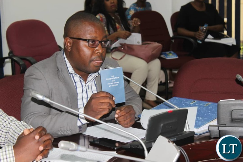 YALI President Andrew Ntewewe shows a copy of the American Constitution to the Committee