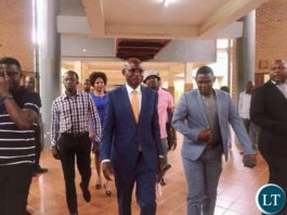 Amos Chanda in the company Chilufya Tayali after Appearing in Court