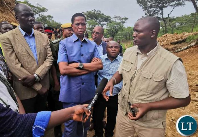 Mines Minister Richard Musukwa with President Lungu at a Potential Gold Mining Site in North Western Province