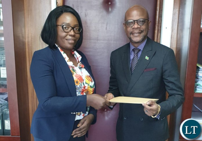 Permanent Secretary of the Ministry of Health Ms. Kakulubelwa Milalelo handing the signed crucial MoU to Ambassador Mukwita in her office in Lusaka recently. Courtesy of the embassy of Zambia in Berlin.