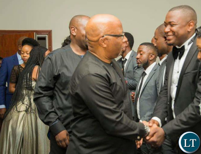 Nevers Mumba shaking hands with the new Deputy S.G Gregory Mofu