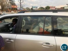 Kitwe Mayor, Christopher Kang'ombe, seen driving out with files from office after Minister suspended Kitwe City Council to pave way for investigation.