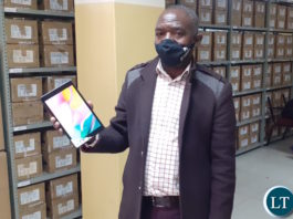 Zambia Statistics Agency (ZamStats) IT assistant programmer Constain Munsaka displays one of the tablets that the Government of Zambia has purchased for use in the 2020 Census of Population and Housing. 9 July 2020. Lusaka. Photo | MNDP