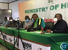 Lusaka Province minister Mr. Bowman Lusambo with Health Minister Dr Chitalu Chilufya at a news briefing