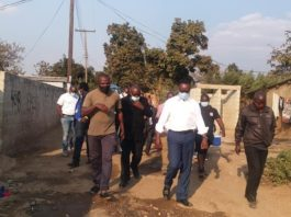 Minister of Water Development, Sanitation and Environmental Protection Dr Jonas Chanda is checking works by the Lusaka Water & Sewerage Company in Mtendere B to establish source of water contamination.