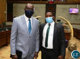 Finance Minister Dr Bwalya Ngandu pose for the picture with Agriculture Minister, Micheal Katambo after presentation of 2021 national budget