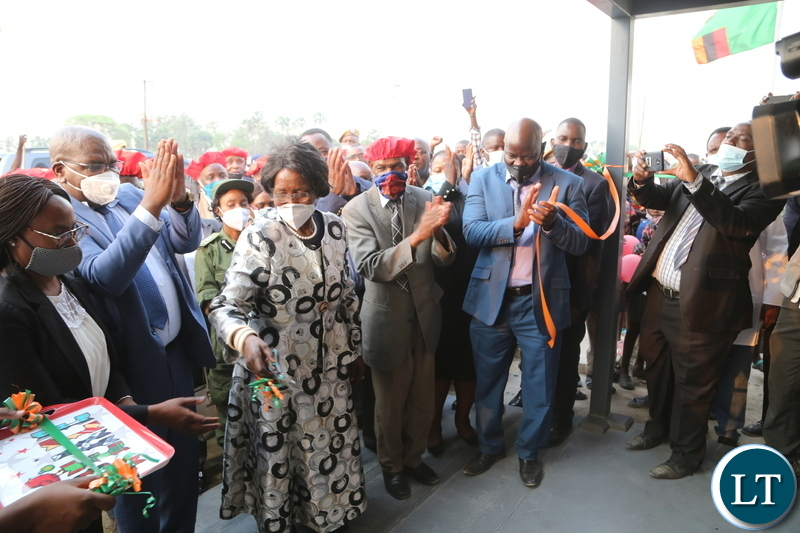 Vice President Inonge Wina, Ngambela Mukela Manyando and Minister of Health Chitalu Chilufya cutting the ribbon to officially commissioning the Lealui Mini hospital in Lealui western province