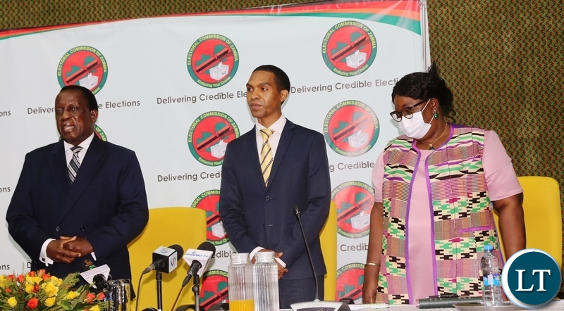 Electoral Commission of Zambia Chief Electoral Officer Patrick Nshindano with Electoral Commission of Zambia Chairperson Judge Esau Chulu and Commissioner Dr Emily Sikazwe during the launch of online voter registration at Mulungushi International Conference center.