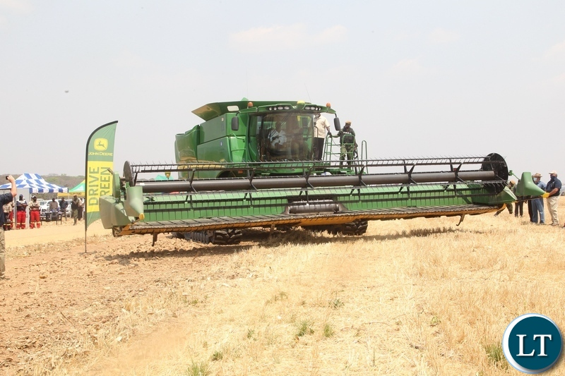 President Edgar Lungu operating the combine harvester during the launch of the national wheat harvest at chobe Agrivision farm in Mkushi district central province
