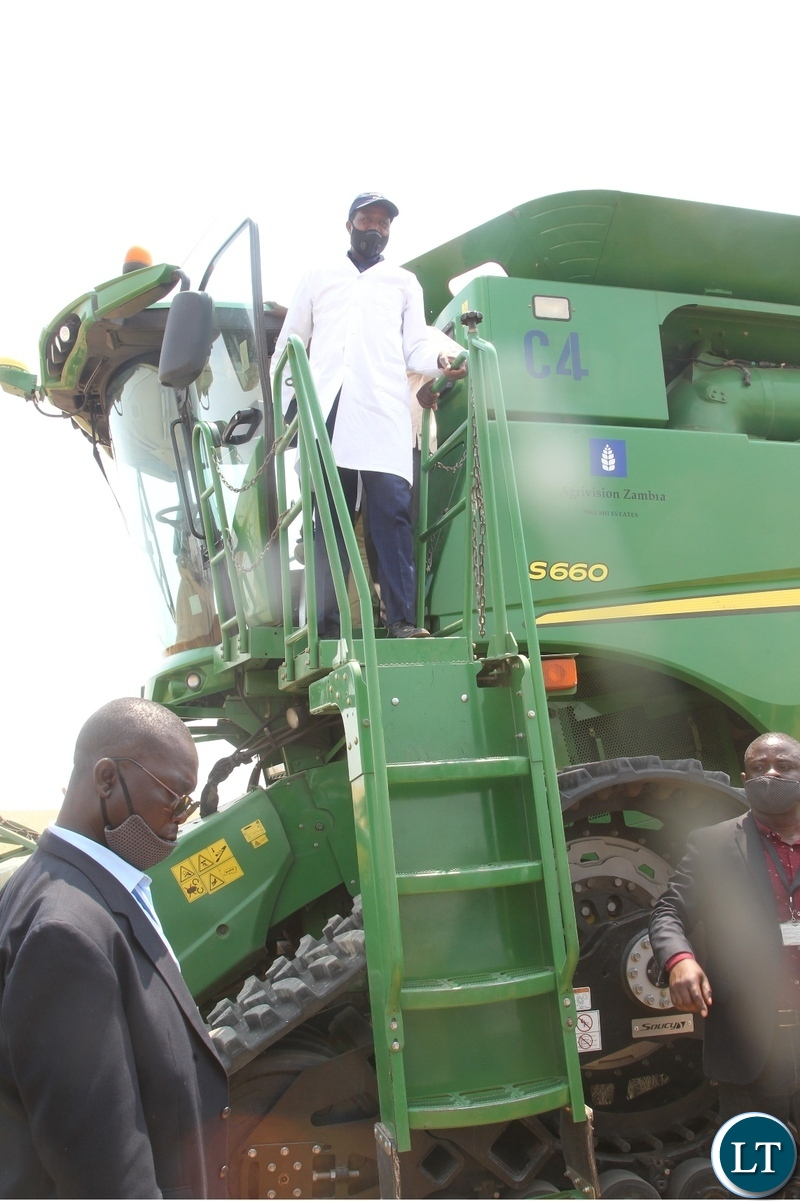 President Edgar Lungu disembarks from the combine harvester during the launch of the national wheat harvest at chobe Agrivision farm in Mkushi district central province