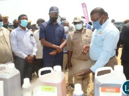 President Edgar Lungu is shown some chemicals used pest control by Mr Addson Ngoma Area Sales Manager central of Buyer Zambia during a mini exhibition at the launch of the national wheat harvest at chobe Agrivision farm in Mkushi district central province