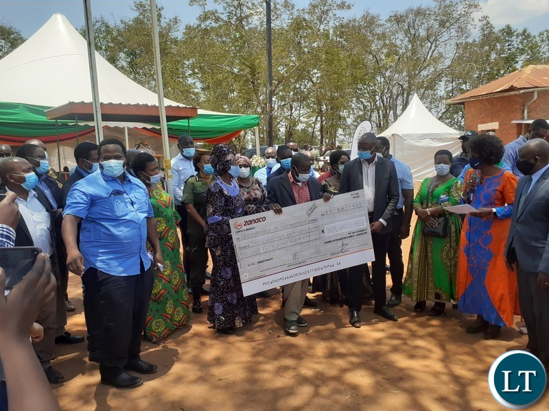 Vice-President Inonge Mutukwa Wina and Minister of National Development Planning Alexander Chiteme hand over Zambia Integrated Forest Landscape Projects grants cheques to Sinda Member of Parliament Masauso Phiri and some of his constituents in Chapata on 17 October 2020. PHOTO   MNDP