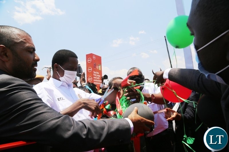 President Edgar Lungu cuts a ribbon to officially commission the newly built Arcades fly-over Bridge in Lusaka. Picture by SUNDAY BWALYA/ZANIS