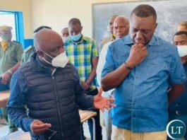 Home Affairs Minister Stephen Kampyongo and Mazabuka Central Member of Parliament Garry Nkombo inspecting NRCs issuance