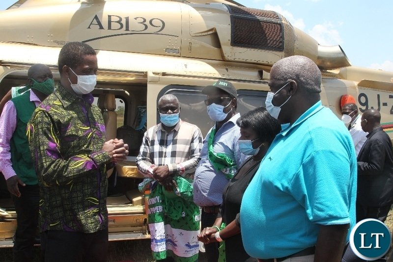 President Lungu confers with Northern Province Minister Bwalya Chungu when he arrived in Chilubi district to drum up support for PF council chairperson candidate in Thursday's by-election.