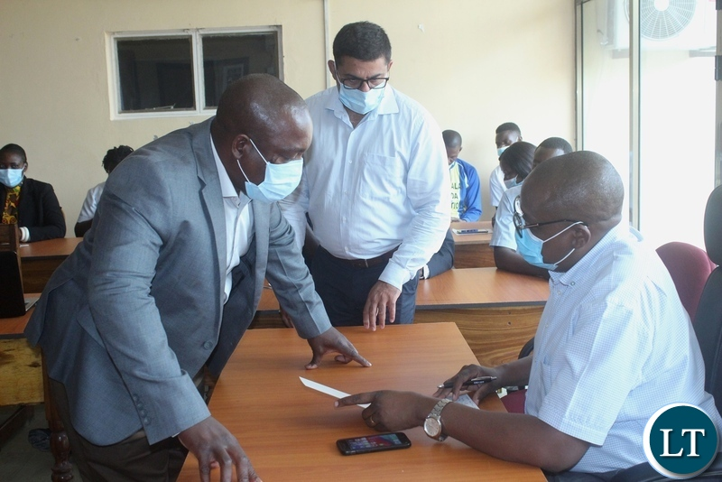Ministry of Health Technical Services Permanent Secretary Dr. Kennedy Malama (r) shares notes with Lewanika General Hospital Medical Superintendent Dr. NjekwaSamutumwa (l) and his deputy Dr. SubhashSoni (c) before addressing health workers in Mongu